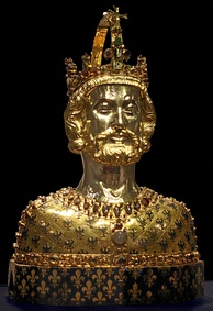 Bust of Charlemagne with the German Reichsadler embossed on the metal and the French fleur-de-lis embroidered on the fabric. Aachen Cathedral Treasury
