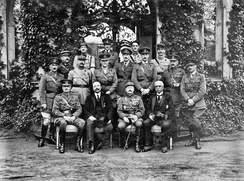 Formal group photograph of British and French officers and commissioners outside the house of the Commander-in-Chief Allied Armies of Occupation, Marienberg