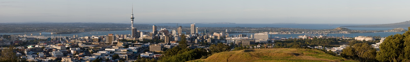 Auckland cityscape viewed from Maungawhau / Mount Eden. The nearer body of water is the Waitematā Harbour and the farther the Hauraki Gulf.