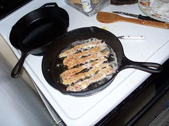 Bacon frying in its own grease