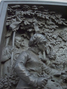 Bronze relief of a memorial dedicated to Bastille Day.
