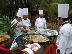 Chefs in Mexico wearing standard uniform.