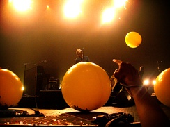 "Coldplay continue to perform songs from Parachutes, such as ""Yellow,"" in live performances."