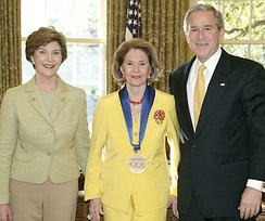 Charisse with George W. and Laura Bush, accepting the National Medal of Arts and Humanities Award in 2006. Photo by Paul Morse