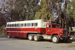 1970s Transtar 4370 towing a trailer bus.