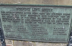 Memorial plaque on Bideford Long Bridge recording the restoration and widening completed in 1925
