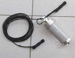 A wire antenna kit, with a coil of wire,  strain insulators and a balun.  When installed the wire is supported by buildings or trees using the insulators to prevent a short circuit to ground.