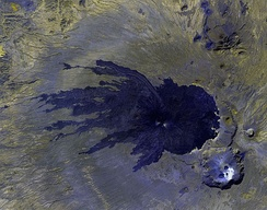 Satellite image of the more recent lava rock, in black, with Toussidé volcano (center) and the Trou au Natron crater (bottom right)