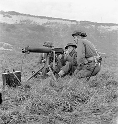 Soldiers of Princess Patricia's Canadian Light Infantry firing a Vickers machine gun during a training exercise, Eastbourne, England, December 3, 1942