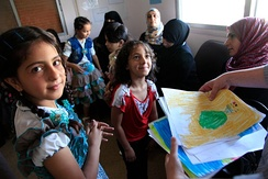 Refugee children from Syria at a clinic in Ramtha, Jordan, August 2013