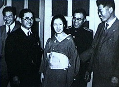 Newspaper photo taken shortly after the arrest of Sada Abe (center) in Tokyo on May 20, 1936