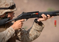 An American marine fires a Benelli M4 shotgun during training in Arta, Djibouti, 23 December 2006.