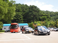 A western-style funeral motorcade for a member of a high-ranking military family in South Korea.