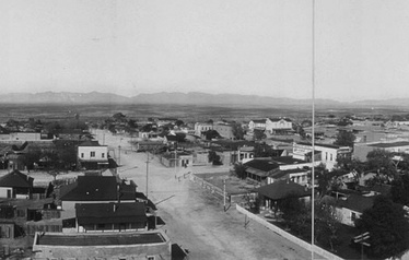 Third St. in Tombstone, Arizona in 1909 from the roof of the Cochise County Courthouse. The O.K. Corral was located on Allen St., the first right turn off Third St. The white building at the center right is Schiefflin Hall on Fremont St.