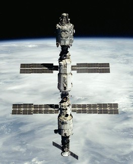 The Progress M1-3 seen docked at the bottom of the Zvezda module of the ISS during STS-106.