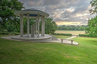 The Magna Carta Memorial at Runnymede, designed by Sir Edward Maufe and erected by the American Bar Association in 1957. The memorial stands in the meadow known historically as Long Mede: it is likely that the actual site of the sealing of Magna Carta lay further east, towards Egham and Staines.[31]