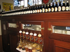 The brewery offers tours and tastings weekly, by reservation. Above the beer taps is a row of Christmas Ale bottles, one from each year beginning 1975.