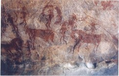 Bhimbetka rock painting showing man riding on horse, India