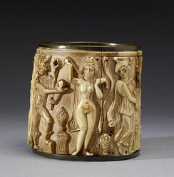 This circular Pyxis or box depicts two scenes.  The one shown presents Hermes awarding the golden apple of the Hesperides to Aphrodite, who Paris has selected as the most beautiful of the goddesses.[119] The Walters Art Museum.