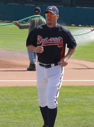 Chipper Jones in a Braves uniform with orange-tinted sunglasses