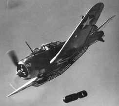US Navy SBD Dauntless dropping its bomb.