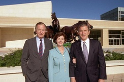Governor Bush (right) with father, former president George H. W. Bush and wife, Laura, in 1997