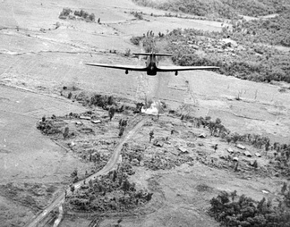 A Hawker Hurricane Mark IV attacks a Japanese position on the Tiddim Road.