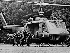 A rifle squad from the 1st Squadron, 9th Cavalry exiting from a UH-1D.