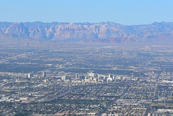 Downtown Las Vegas with Red Rock Canyon in the background.