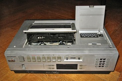 Top-loading cassette mechanisms (such as the one on this VHS model) were common on early domestic VCRs.
