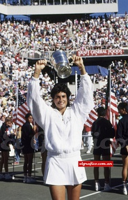 Sabatini raising the trophy won at the 1990 US Open after her victory over Steffi Graf