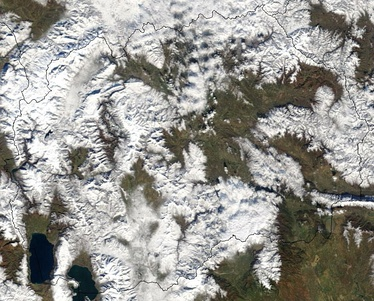 Photo of a cloud-covered Macedonia taken from space