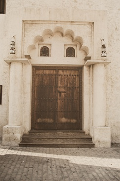 An old door in Sharjah, displaying the historical architecture of the city.