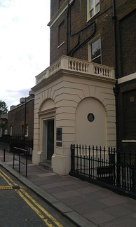 The Faber and Faber building where Eliot worked from 1925 to 1965; the commemorative plaque is under the right-hand arch.
