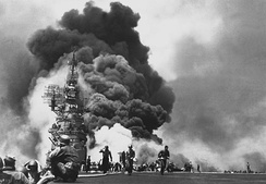 USS Bunker Hill burns after being hit by two kamikazes. At Okinawa, the kamikazes caused 4,900 American deaths.