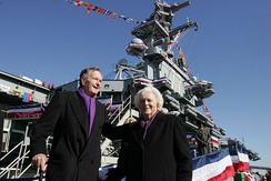 George H. W. Bush and Barbara Bush depart the ship following the commissioning ceremony