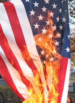 U.S. flag being burned in protest on the eve of the 2008 election