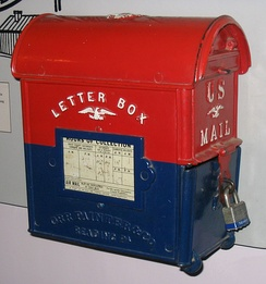 "This antique ""letter-box"" style U.S. mailbox is both on display and in use at the Smithsonian Institution Building."