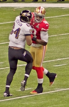 Smith takes on block by tight end Ed Dickson in Super Bowl XLVII