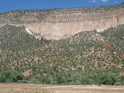 Bandelier Tuff at San Diego Canyon. The lower Otowi Member is a single massive cooling unit, while the upper Tshirege Member is composed of multiple cooling units.