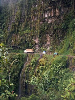 Bolivia is RHT, with the exception of Yungas Road which is LHT to help drivers see their outer wheel.