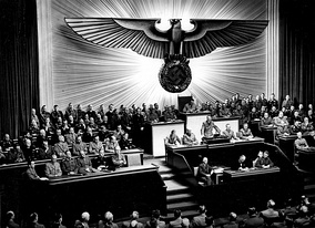 11 December 1941: Adolf Hitler speaking at the Kroll Opera House to Reichstag members about war in the Pacific.[s]