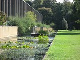 A view of the water garden along the west side of the site, toward the small bridge that was part of the original entrance sequence.