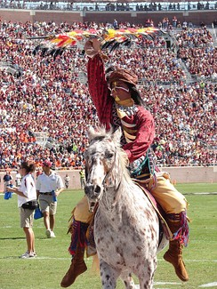 A student acting as Chief Osceola, the Florida State University mascot
