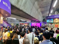 A crowded BTS Station during the rush hour in Bangkok, Thailand