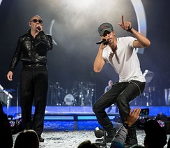 Pitbull performing with Enrique Iglesias at the Frank Erwin Center in Austin, Texas, 2015