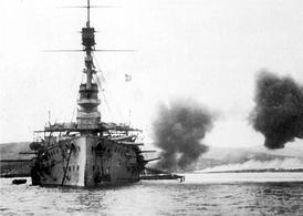 Cornwallis fires a broadside during the withdrawal from Suvla Bay in December 1915. Photo by Ernest Brooks.