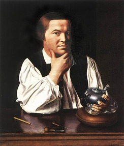 Paul Revere with a silver teapot and some of his engraving tools.
