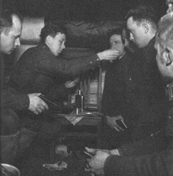 A Finnish military chaplain administering Holy Communion during the Second World War. The shared experience of battle shaped the Church and the society for decades and affected the stance of the Church in social policy strongly.