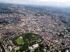 Aerial view of Lausanne (railway station in the centre and Parc de Milan at the bottom).